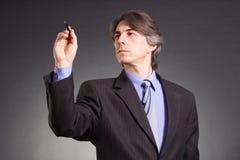 Businessman writes Royalty Free Stock Photos