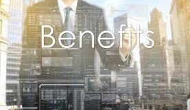 Businessman writes on board text: Benefits Stock Photo