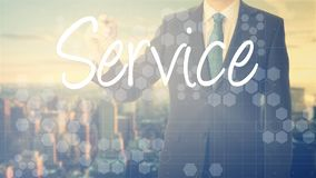 businessman writes on board text: Service - with sunset over the royalty free stock photos