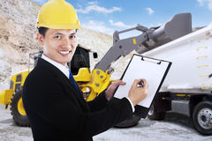 Businessman writes on a clipboard at mining site Royalty Free Stock Photos