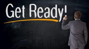 Businessman writes get ready on blackboard concept royalty free stock photos