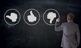 Businessman writes Like Buttons on blackboard Concept.  stock photography