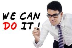 Businessman writes motivation words 2 Stock Photos