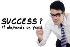 Businessman writes motivation words 1 Royalty Free Stock Image