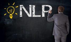 Businessman writes NLP on blackboard concept