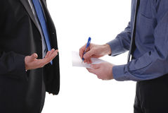 Businessman writes notes Stock Image