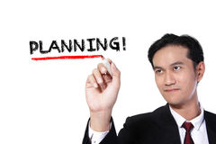 Businessman writes Planning royalty free stock photo