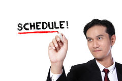Businessman writes Schedule royalty free stock image