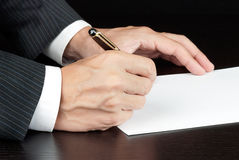 Businessman Writes, Side View Stock Photography