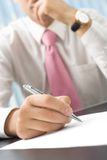 Businessman writing stock image