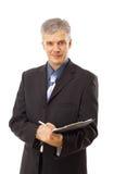 Businessman writing. Isolated over white background Stock Image