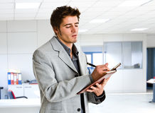 Businessman writing Stock Photo