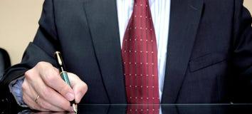 Businessman writing. With pen -closeup Stock Photo