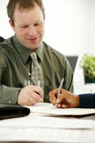 Businessman Writing Stock Photo