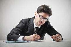 Businessman writing Stock Photography