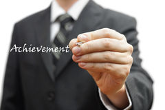 Businessman writing achievement word virtual Royalty Free Stock Photos
