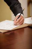 Businessman writing on agenda left hand Stock Image