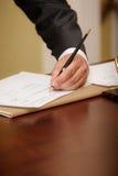 Businessman writing on agenda left hand Stock Image