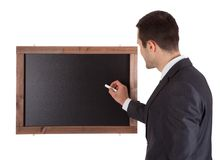 Businessman writing on blackboard Royalty Free Stock Images