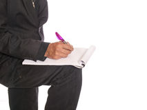 Businessman with a writing block Royalty Free Stock Photo