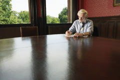 Businessman Writing In Boardroom Stock Photos