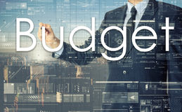 The businessman is writing Budget on the transparent board Stock Photo