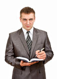 Businessman writing in business diary Stock Photography