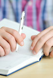 Businessman writing in business diary Royalty Free Stock Photo
