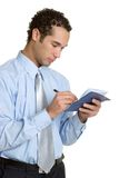 Businessman Writing Check. Happy young businessman writing check Royalty Free Stock Photos