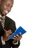 Businessman Writing Check. African american businessman writing check Royalty Free Stock Photography