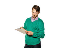 Businessman writing in a checklist. Stock Images