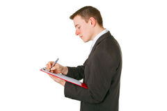 Businessman writing on a clipboard Royalty Free Stock Images