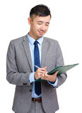 Businessman writing on clipboard Royalty Free Stock Photo