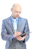 Businessman writing on clipboard Stock Images