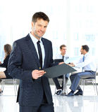 Businessman writing on a clipboard Stock Photo