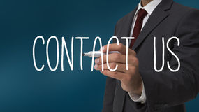 Businessman writing contact us Royalty Free Stock Photo
