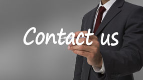 Businessman writing contact us with a marker Royalty Free Stock Images