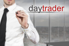 Businessman writing daytrader in the air Royalty Free Stock Photography