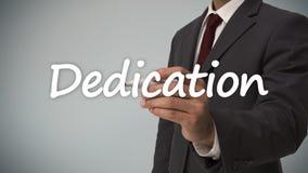 Businessman writing dedication. Against grey background Royalty Free Stock Photos