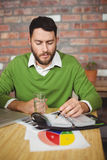 Businessman writing in diary. At creative office Royalty Free Stock Photo