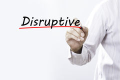 Businessman writing. `Disruptive` on whiteboard with marker Stock Photography
