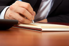 Businessman writing document Royalty Free Stock Images