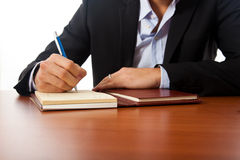 Businessman writing document Royalty Free Stock Photo