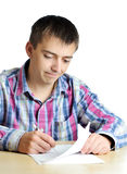 Businessman writing on document. Close-up of young businessman writing on document Stock Images