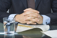 Businessman writing in a document royalty free stock photos