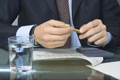 Businessman writing in a document Stock Photography