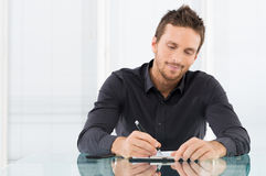 Businessman Writing Document Royalty Free Stock Image