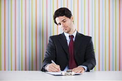 Businessman writing documents Stock Photos