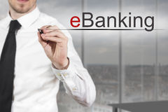 Businessman writing eBanking in the air Stock Images