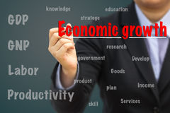 Businessman writing Economic growth relation concept. Royalty Free Stock Image